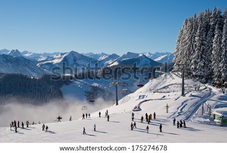 Skiers on the slope of Austrian Alpes. - stock photo