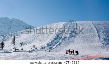 Skiers on the slope of winter resort Bansko, Bulgaria - stock photo