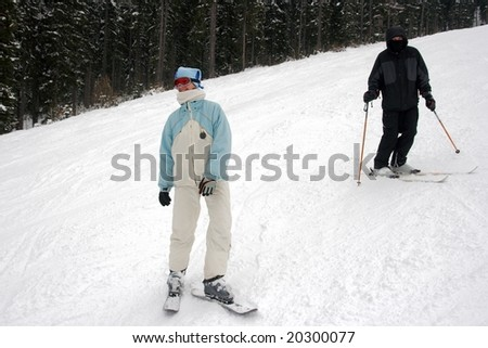 Skiers on the white slope - stock photo