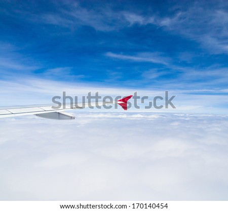 Skies above and below Wing over Lands  - stock photo