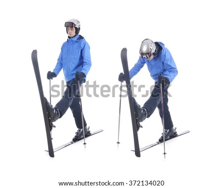 Skiier demonstrate warm up exercise for skiing. Pull up skis, bend forward and stretch.