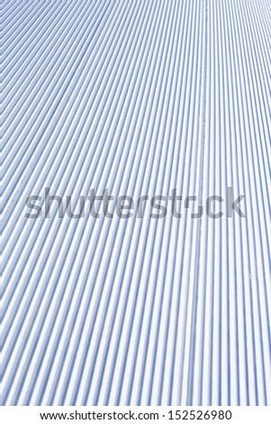 Skiing background - fresh snow on ski slope - stock photo
