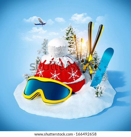 skiing equipment on the snowdrift at blue background. Winter holidays - stock photo