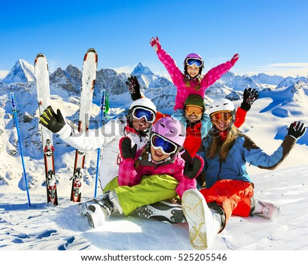 Skiing Family Enjoying Winter Vacation On Snow In Sunny Cold Day Mountains And Fun