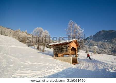 Skiing in a winter landscape with wooden barn, Pitztal Alps - Tyrol Austria Europe - stock photo