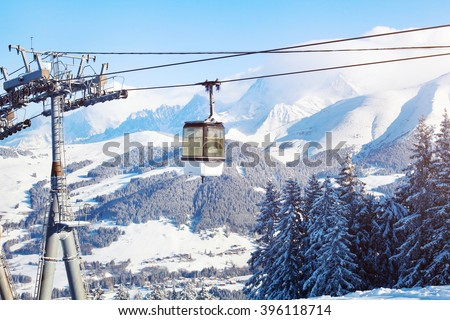 skiing in Alps, ski lift cabine and beautiful mountain panoramic landscape - stock photo