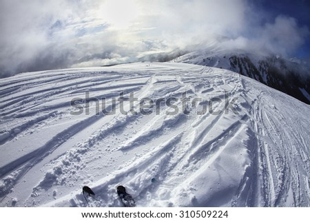 Skiing in the Dolomites, view of the slopes on skis and mountain peaks. Val di Fiemme, Italy - stock photo