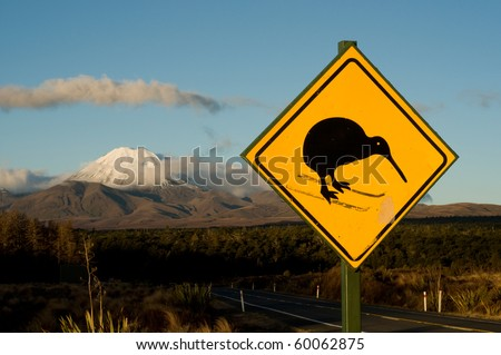 Skiing kiwi sign next to Mt Ruapehu (Mt Doom) - stock photo