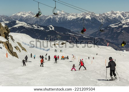 Skiing people and the chair lifts of ski region in Austria - stock photo