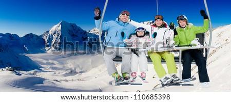 Skiing, ski lift, winter - skiers on ski holiday - stock photo