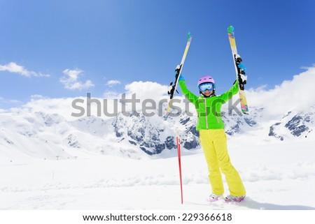 Skiing, skier, winter fun - lovely skier girl enjoying ski vacation - stock photo