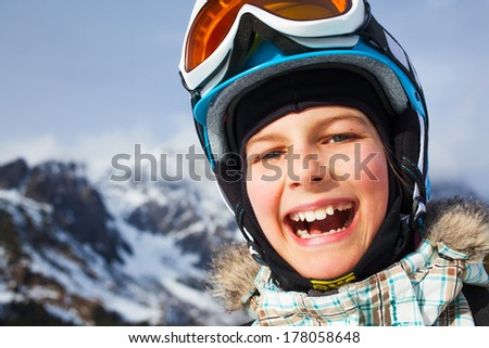Skiing, skier, winter sports - closeup portrait of happy young skier - stock photo