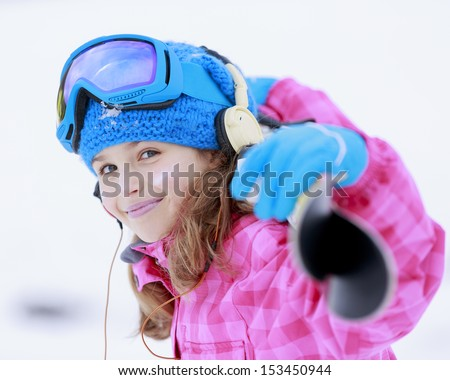 Skiing, skier, winter sports - portrait of happy young skier - stock photo