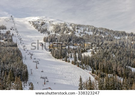 Skiing slopes with chairlift on ski resort in Austrian Alps