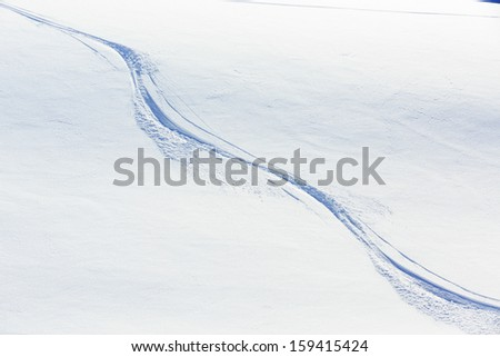 Skiing, snow - freeride tracks on powder snow - stock photo