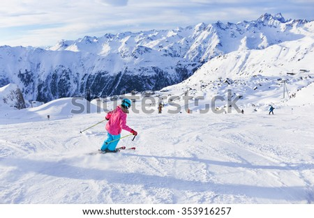 Skiing, winter, child - portrait of young skier girl in helmet and goggles in winter resort