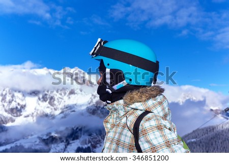 Skiing, winter, child - young skier girl in winter resort - stock photo