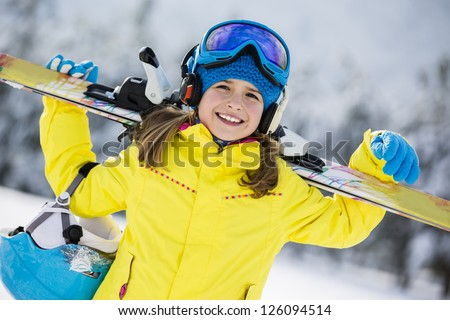 Skiing, winter, child - young skier in winter resort - stock photo