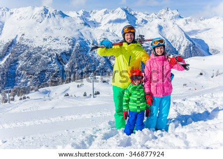 Skiing, winter fun - happy family on ski holiday - stock photo