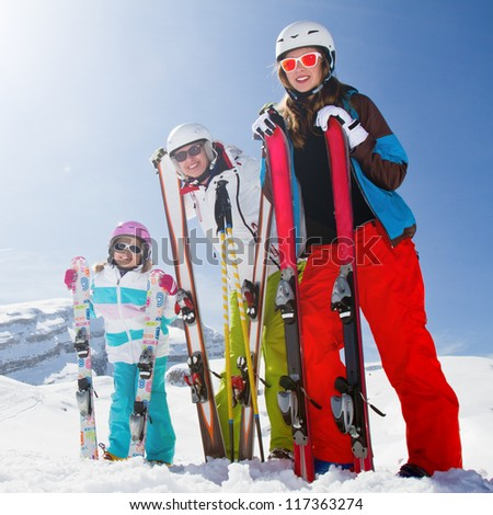 Skiing, winter fun - happy skiers on ski holiday - stock photo