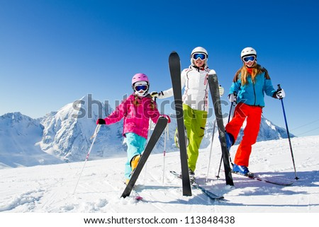 Skiing, winter - happy skiers on mountainside - stock photo