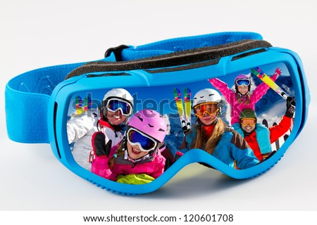 Skiing,winter - reflection of the portrait of the family in ski goggles - stock photo