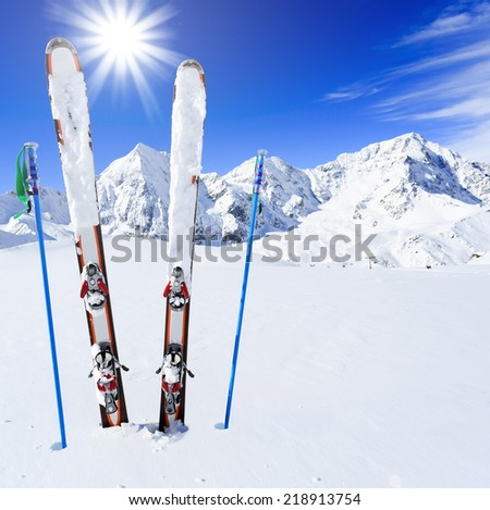 Skiing, winter season , mountains and ski equipments on ski run - stock photo
