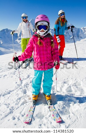 Skiing, winter, ski holiday  -   skiers on mountainside, portrait of female skiers - stock photo