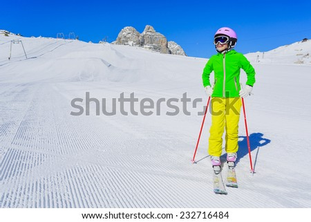 Skiing, winter, ski vacation - young skier on mountainside - stock photo