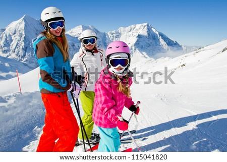 Skiing, winter- skiers on mountainside - stock photo