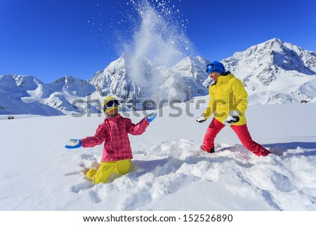 Skiing, winter, snow, skier, sun and fun - family enjoying winter vacations - stock photo