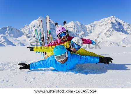 Skiing, winter, snow,  skiers, sun and fun - family enjoying winter vacations - stock photo
