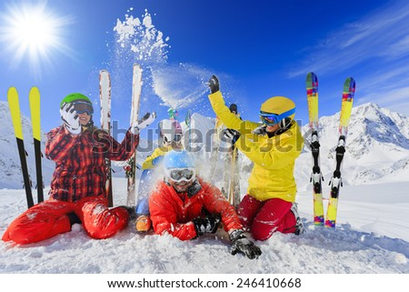 Skiing, winter, snow, skiers, sun and fun - family enjoying winter vacations, filtered - stock photo