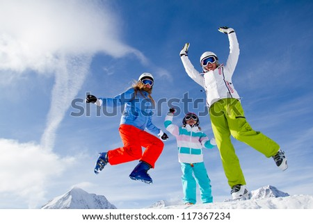 Skiing, winter, snow, sun and fun - family enjoying winter vacations - stock photo