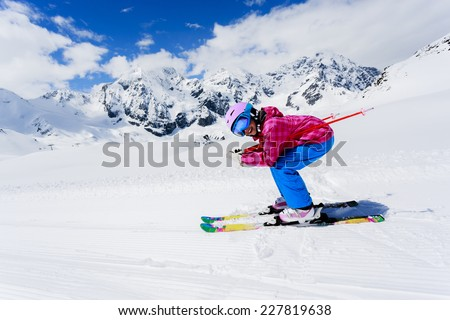 Skiing, winter sport - girl skiing downhill - stock photo
