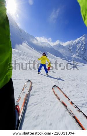 Skiing, winter sport - skiers on mountainside - stock photo