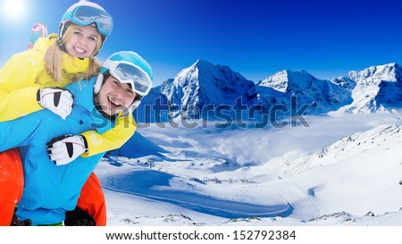 Skiing, winter sports - portrait of young skiers, couple having fun on ski - stock photo
