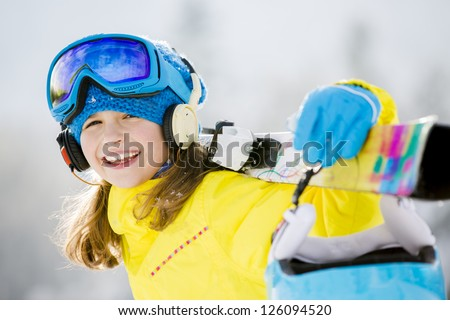 Skiing, winter, teenage girl  - young skier in winter resort - stock photo