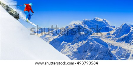 Skiing with amazing view of swiss famous moutains in beautiful winter snow.