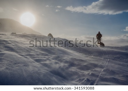 Skiing with Expedition sledge in Northern Sweden  - stock photo