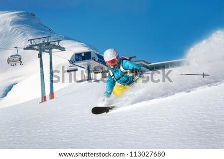 Skiing woman having fun - stock photo