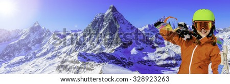 Skiing, Young skier with view of Matterhorn on a clear sunny day - Zermatt, Switzerland