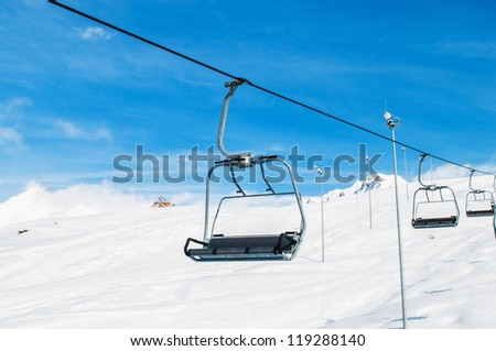 Skilift on bright winter day - stock photo