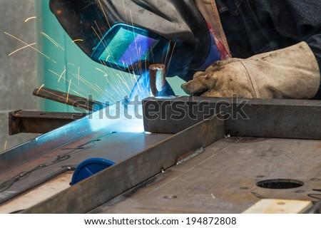 Skill worker performs gas metal arc welding (especially metal inert gas or MIG welding) - stock photo