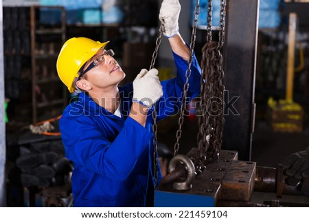 skilled male industrial worker at work - stock photo