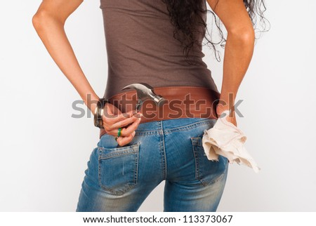 Skilled woman with a hammer in her pocket