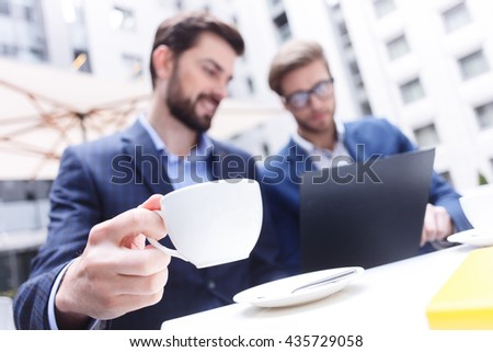 Skillful male colleagues are discussing a business project - stock photo
