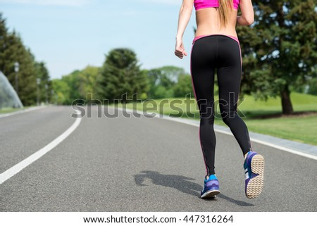 Skillful runner jogging in the nature - stock photo