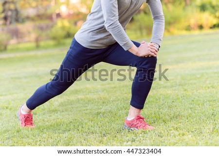 Skillful sportsman doing exercise outdoors - stock photo