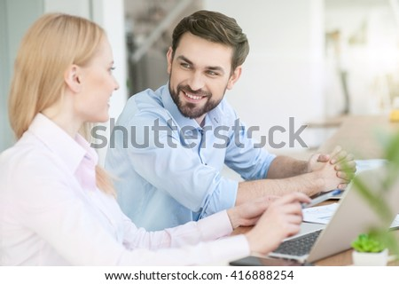 Skillful two colleagues are working in cooperation - stock photo